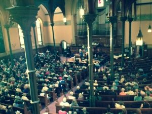 The crowd to benefit medical assistance for Syrian Refugees in the First Churches Sanctuary